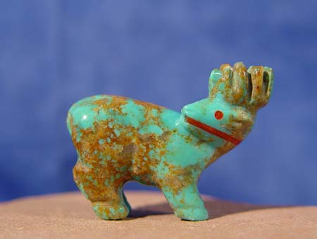 Zuni Indian Pueblo carving of elk in turquoise with coral heartline and eyes