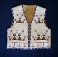 Professional restoration of Antique American Indian beadwork vests bags cradles shields